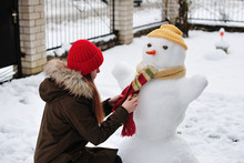 The Girl And A Snowman
