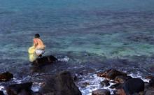 Fisherman Waits With His Net