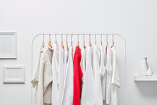 Single Red Shirt On Rack With Clothes