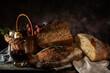 Leinwandbild Motiv Still life bread in basket and bottle of wine. on a wooden basis