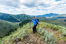 Smiling Mature Woman Hiking In Sun Valley, Idaho, USA