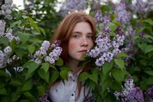 Portrait Of Teenage Girl Standing Among Flowers