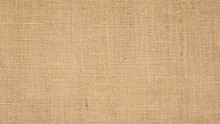 Hessian Sackcloth Burlap Woven Texture Background  / Cotton Woven Fabric Background With Flecks Of Varying Colors Of Beige And Brown. With Copy Space. Office Desk Concept.High Resolution Horizontal
