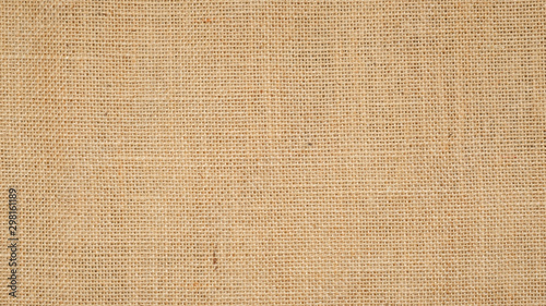 Fotomural Hessian sackcloth burlap woven texture background  / cotton woven fabric background with flecks of varying colors of beige and brown