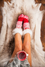 Girl In Red Christmas Socks Enjoying A Winter Time With A Cup Of Hot Tea.