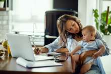 Young Mother Working On Home F...
