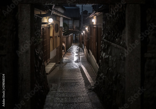 Garden Poster Narrow alley Empty alley through traditional Kyoto neighborhood on rainy night