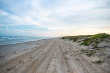 Sunrise And Sunset Along The Dunes Of Mustang Island On The Texas Coast
