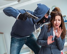 The Criminal Taking Businesswoman As Hostage In Office