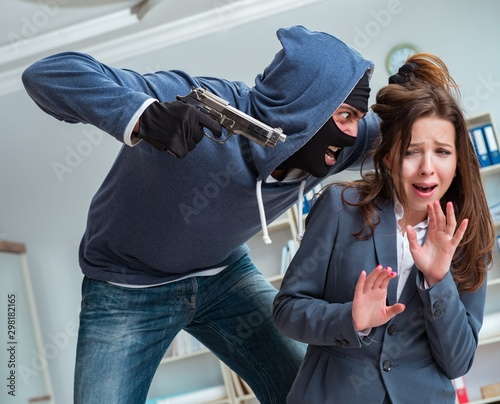 Fotografía  The criminal taking businesswoman as hostage in office