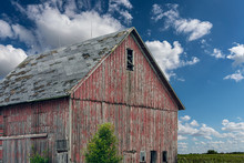 An Old, Red Wooden Barn With P...