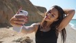 Young adult woman making selfie on her smartphone