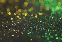 Wallpaper Phone Shining Glitter.New Year And Christmas  Background. Gold And Green Glitter Macro Background With Shining Bokeh On A Black Background. Shining Texture