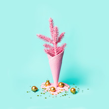 Painted Pink Ice Cream Cone With Christmas Tree And Fallen Golden Balls And Sparkles. Minimal Holiday Concept