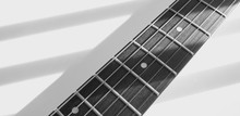 White Guitar Closeup . White Background