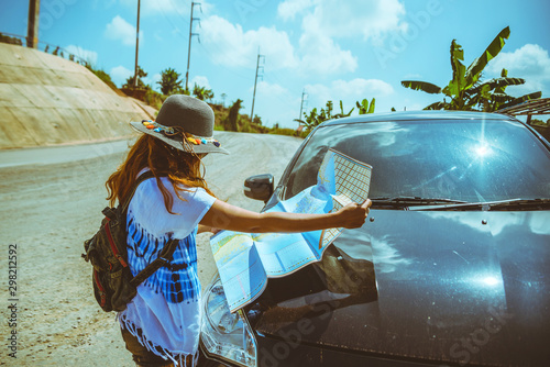 Canvas Prints Fishing woman travel relaxing nature mountain map navigation. Travel relax in the holiday. View map travel explore. The girl standing view map travel explore beside the car. In Thailand