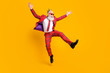 Leinwandbild Motiv Full length body size view of his he nice handsome attractive cheerful cheery carefree gray-haired man jumping having fun rejoice isolated over bright vivid shine vibrant yellow color background