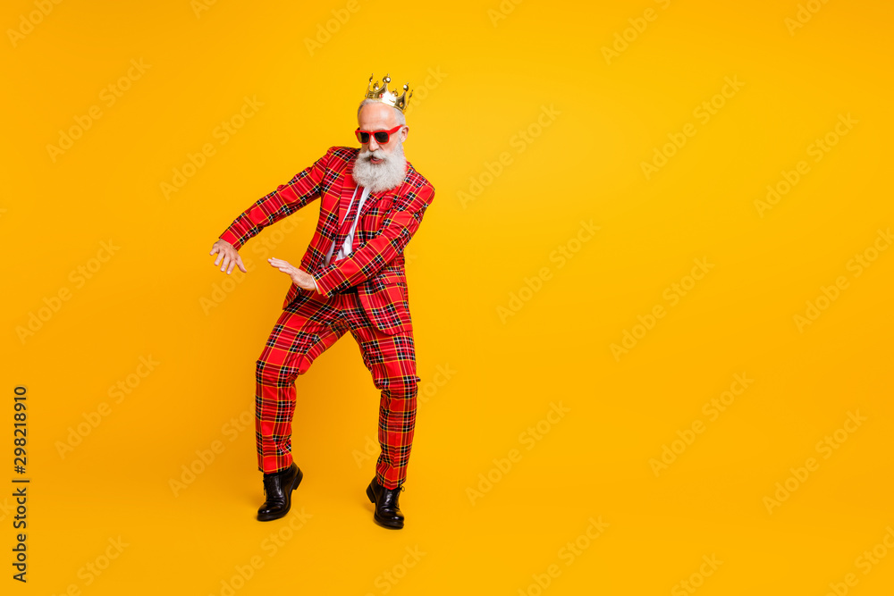 Fototapeta Full body photo of funny grandpa white beard dancing strange youngster moves little drunk wear crown sun specs gingham red costume isolated yellow color background