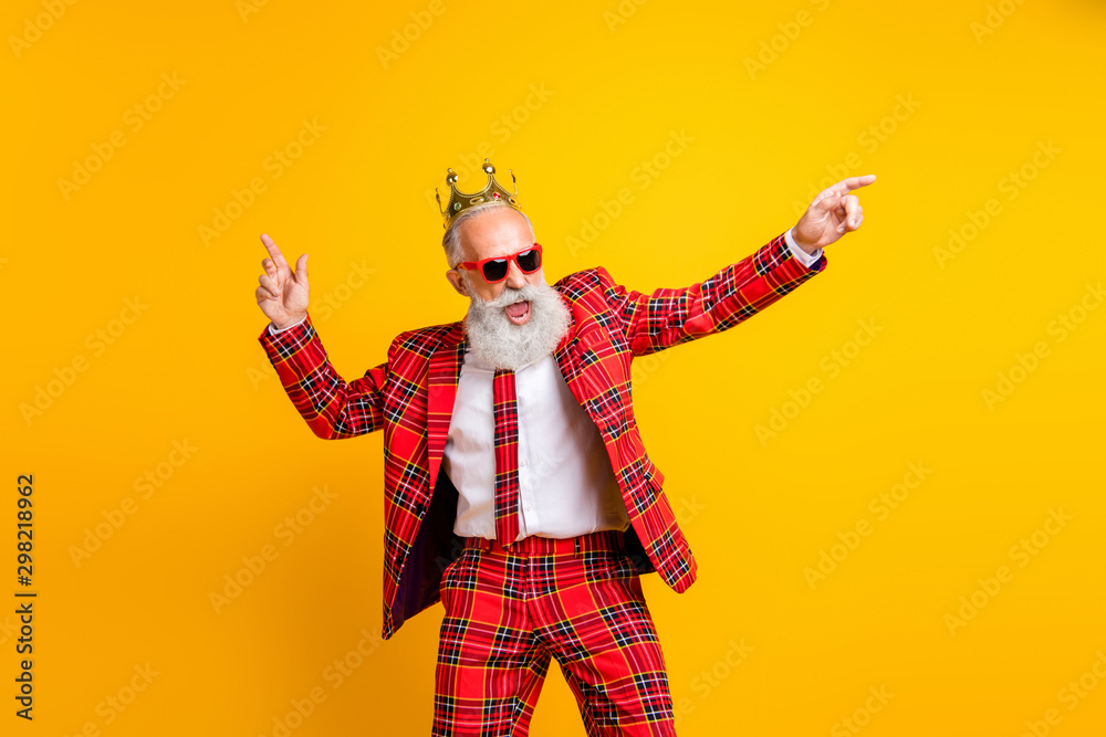 Fototapeta Photo of cool trendy look grandpa white beard dancing hip-hop strange moves wear crown sun specs plaid red blazer tie pants outfit isolated yellow color background