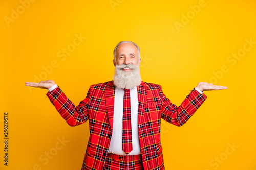 Photo of funny grandpa guy holding open palms empty space two novelty products w Wallpaper Mural