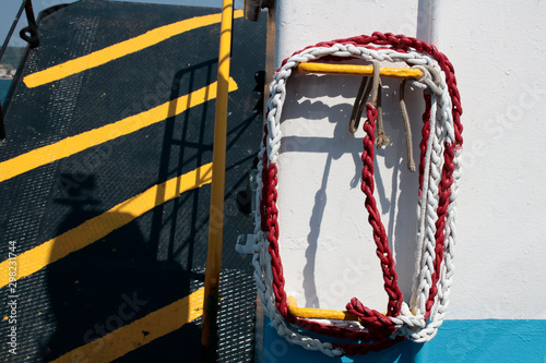 Valokuvatapetti Rope wrapped in red white color on ferry.