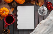 Planning To Do List. Autumn Mood Composition On A Wooden Table With Pumpkins, Rowan And Leaves. Open Notepad With Pen And Black Coffee In The Red Cup And On Grey Wooden Background, Warming Drink