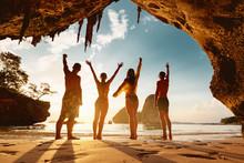 Four Happy Friends Celebrating Something On Beach