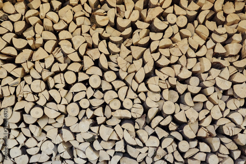 wall firewood. background of dry chopped firewood logs in a pile Fototapeta
