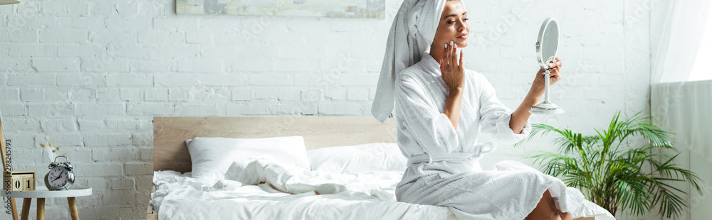 Fototapety, obrazy: panoramic shot of attractive woman in bathrobe and towel looking at mirror at morning