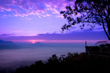 View Of The Misty Landscape With Morning Sunrise At Phu Thok Mountain, Chiang Khan, Loei Province, Thailand