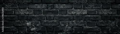 Fototapeta  Black rough brick wall close-up wide texture