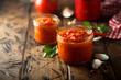 Leinwandbild Motiv Homemade tomato sauce in the jars
