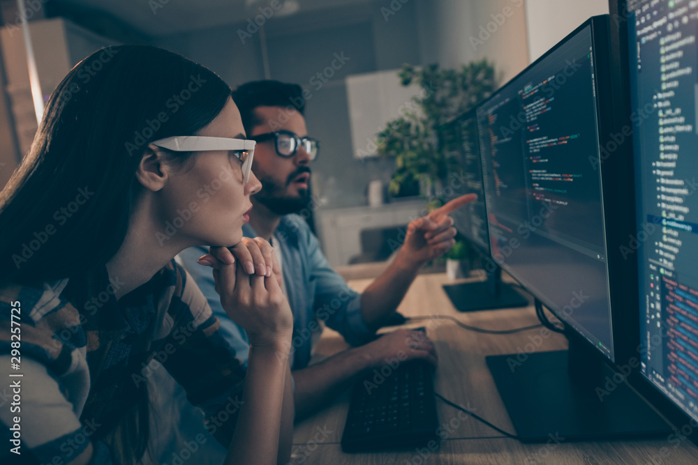 Profile photo of it specialist guy lady two business people night coworking watch together indicate monitor testing debugging java script code smart professionals office indoors