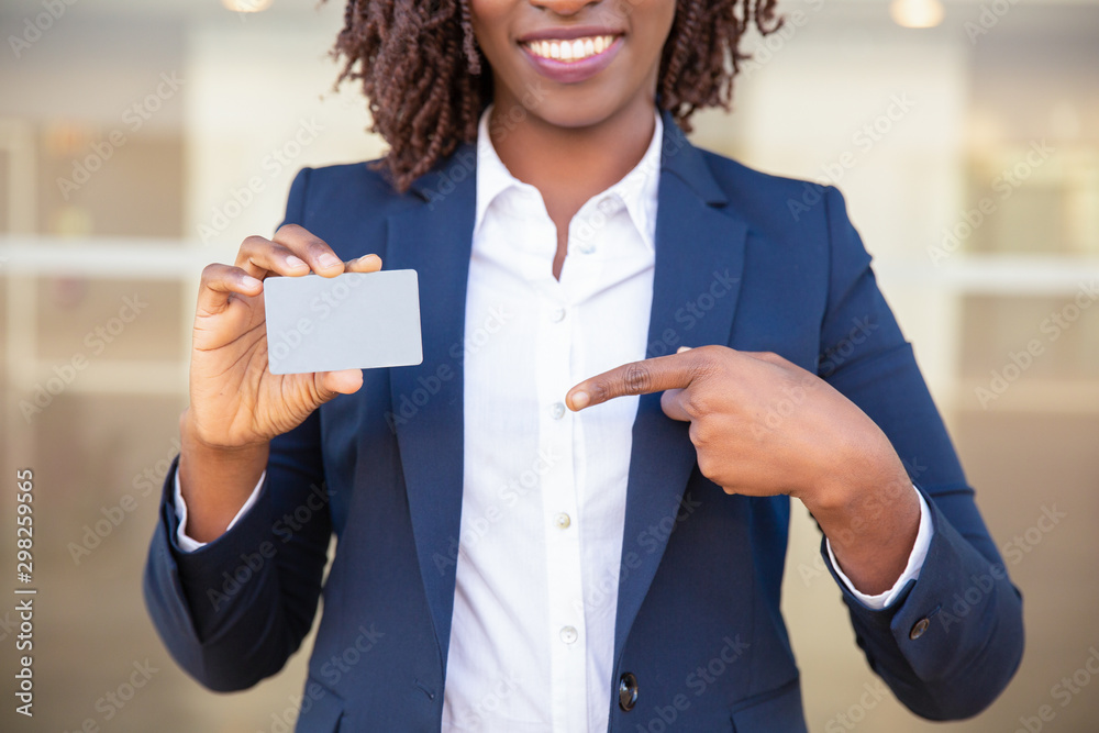 Fototapety, obrazy: Happy successful businesswoman showing id card. Young African American business woman pointing at blank card, smiling. Advertising concept
