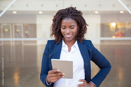 Cheerful manager with tablet getting good news Wallpaper Mural