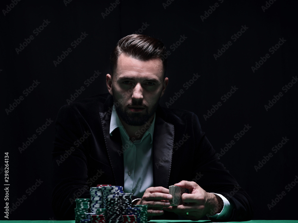 Fototapety, obrazy: A wealthy man playing poker with the excitement in a casino.