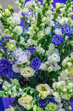 Beautiful bouquet of white, blue and two-tone eustoma close-up. Selective focus, varieties of modern selection