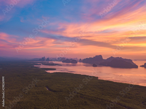 Foto auf Gartenposter Lachs Aerial top view of Samet Nangshe, mountain valley hills, and tropical green forest trees at sunset with Andaman sea in Phang Nga Bay in summer, Thailand in travel trip. Natural landscape background.