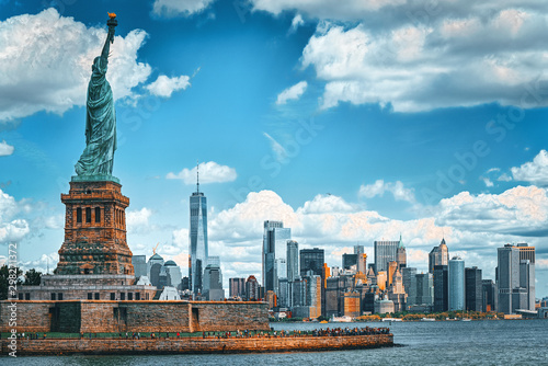 Statue of Liberty on Liberty Island on the background New York Harbor and New York City.