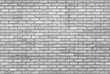 Leinwanddruck Bild - monochrome grey brick wall with repeating pattern
