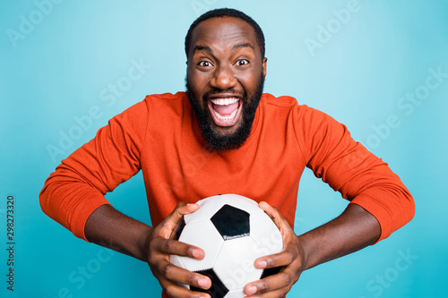Portrait of cheerful excited mixed-race overjoyed ecstatic man holding ball rejo Fototapet