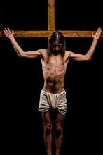 Shirtless Jesus Crucified On Wooden Cross Isolated On Black