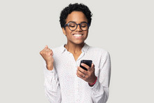 Head Shot Happy African American Girl Using Phone, Celebrating Success