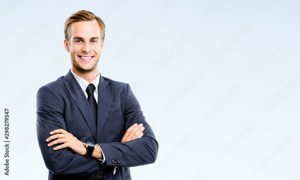 Fototapeta Portrait of happy smiling confident businessman, isolated over grey color background. Business success concept. Copy space for some text or advertise slogan.