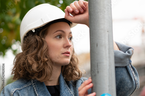 Pinturas sobre lienzo  Close up portrait of a pensive and contemplative factory female employee wearing