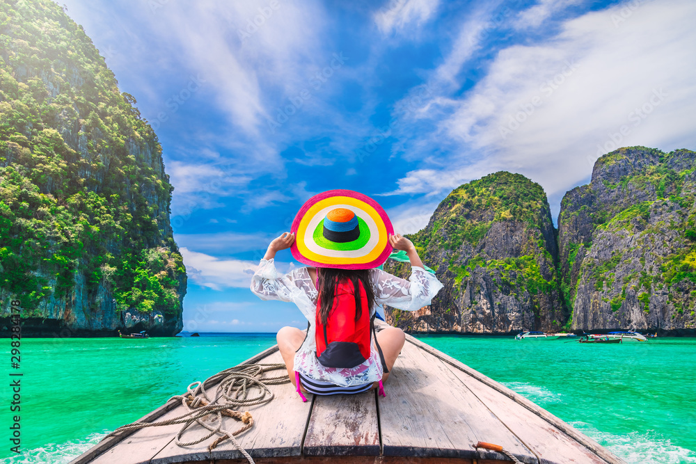 Fototapety, obrazy: Colorful summer lifestyle traveler woman joy fun relaxing on boat at sunny beach Maya bay Krabi, Tourist girl on holiday vacation trip, Travel Phuket Thailand, Tourism beautiful destination place Asia