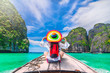 canvas print picture Colorful summer lifestyle traveler woman joy fun relaxing on boat at sunny beach Maya bay Krabi, Tourist girl on holiday vacation trip, Travel Phuket Thailand, Tourism beautiful destination place Asia