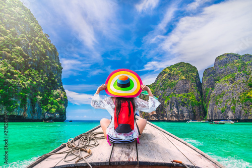 Colorful summer lifestyle traveler woman joy fun relaxing on boat at sunny beach Canvas