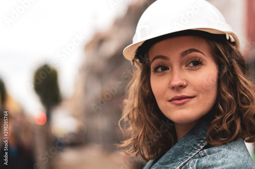 Close-up portrait of a pretty and young female factory worker wearing a white pr Canvas Print