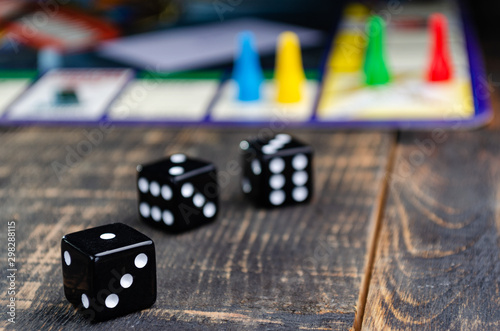 three black dice for a board game on the board Tableau sur Toile